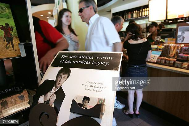 Advertisements for the new Paul McCartney album Memory Almost Full are displayed at a Starbucks store June 5 2007 in New York City The coffee...