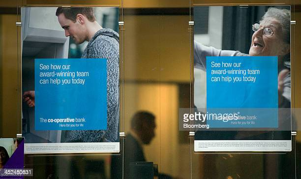 Advertisements hang in the window display of a CoOperative Bank Plc bank branch in London UK on Friday Nov 29 2013 CoOperative Bank Plc which is...