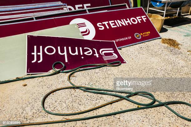 Advertising banners for Steinhoff International Holdings NV lay on the ground following their removal from the grounds of the University of...