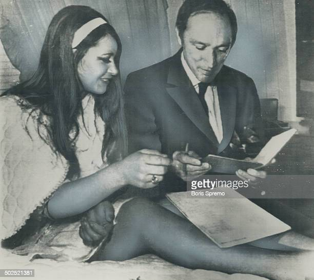 Advertising bedding material at a trade fair in Wanganui NZ 18yearold Carol Hendry lounging on a bed in a silk negligee managed to Prime Minister...