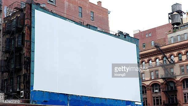 werbung plakat in manhattan, new york - malerleinwand stock-fotos und bilder