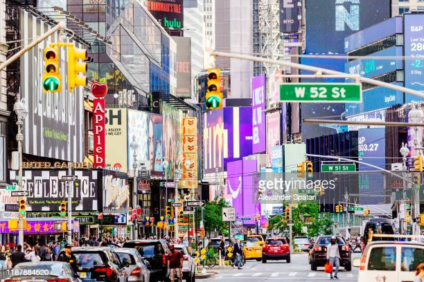 advertising billboards and screens at broadway in manhattan, new york city - broadway manhattan stock pictures, royalty-free photos & images