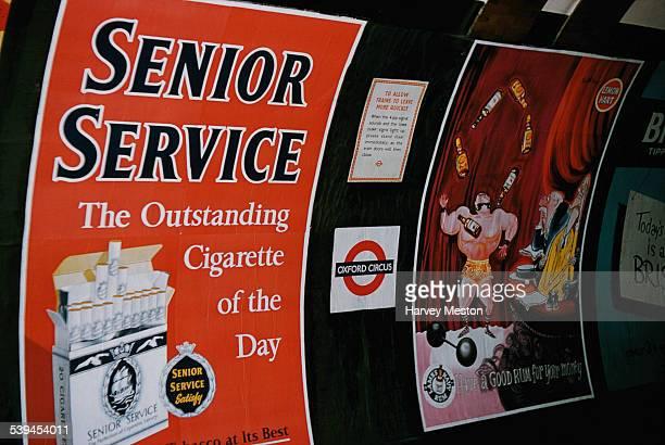 Advertising billboards on Oxford Circus underground station London England circa 1960