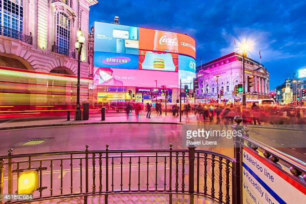 Advertising boards and tourists in Piccadilly Circus in London at night