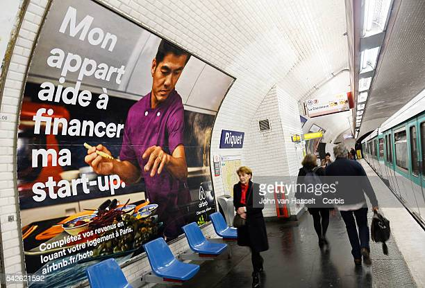 Advertising campaign billboards in the Paris metro for Airbnb Billboard translates My Apartment helps finance my startup Airbnb is the world's...