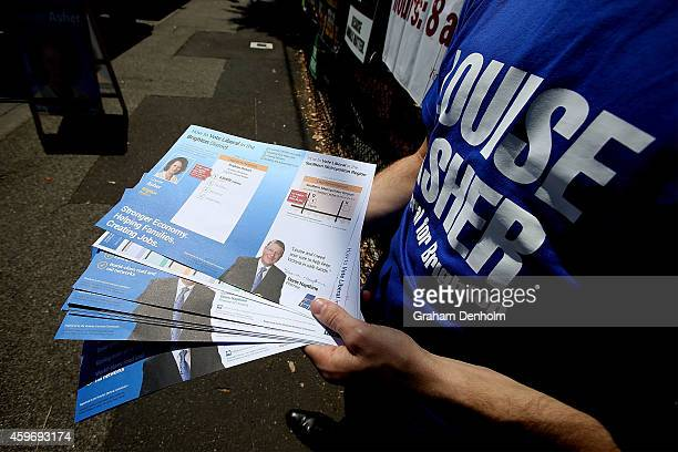 Advertising collateral is handed out to voters at the Brighton District voting centre for the Victorian State Election on November 29 2014 in...