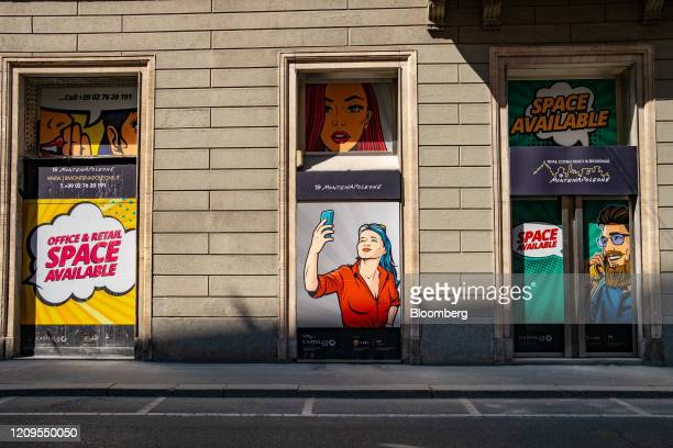 Advertising for an empty shop and office space sits on a building on Via Monte Napoleone the fashion district artery in Milan Italy on Wednesday...