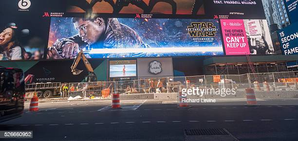 Advertising for J.J. Abrams' Star Wars: The Force Awakens, which will premiere in two weeks, on a giant LED screen in Times Square in New York.