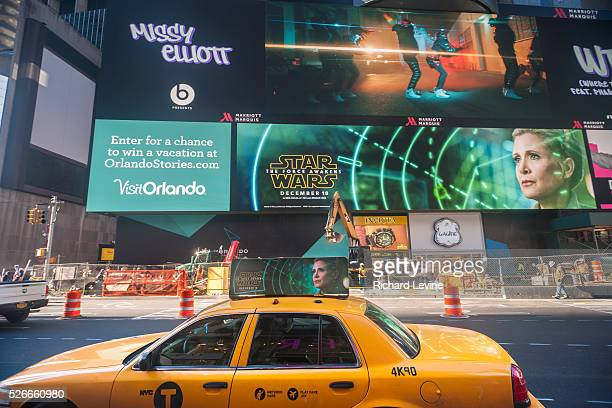 Advertising for J.J. Abrams' Star Wars: The Force Awakens, which will premiere in two weeks, on a giant LED screen and on a taxicab in Times Square...