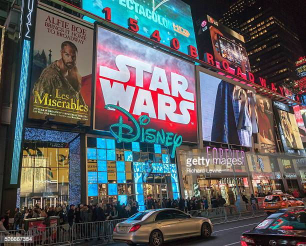 Advertising for J.J. Abrams' Star Wars: The Force Awakens, which will premiere in two weeks, on a giant LED screen above the Disney Store in Times...