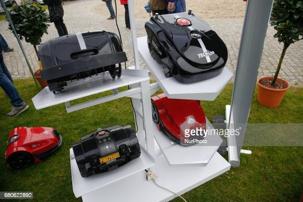 Advertising for lawn mover robots is seen on the Mill Island on 6 May 2017 during a flower show
