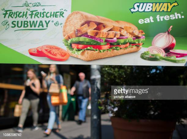 Advertising hangs in the window for Subway in Hannover, Germany, 21 August 2015. The sandwich fast food chain will celebrate its 50th birthday on 28...