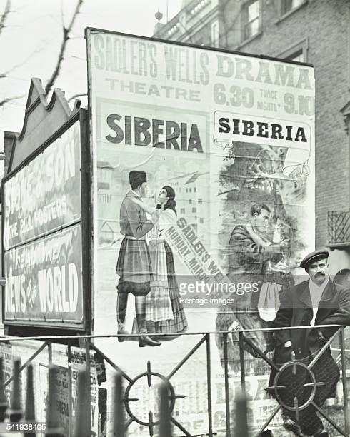 Advertising hoardings 344 City Road London 1911 Large advertisements for Sadler's Wells Theatre and the News of the World on hoardings in front of...