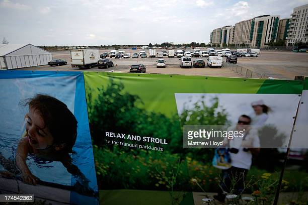Advertising separates the completed North section of the Queen Elizabeth Olympic Park from construction areas during the Open East Festival on July...