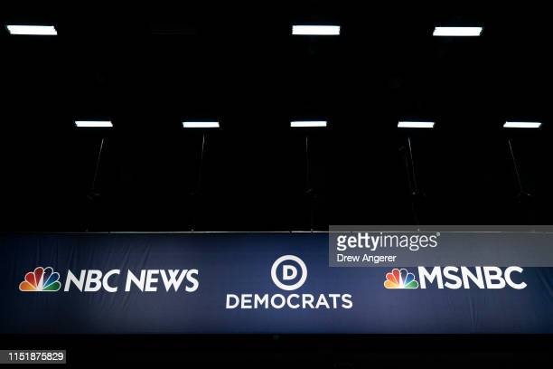 Advertising signage for NBC News and the Democratic Party is seen inside the media filing center at Adrienne Arsht Center for the Performing Arts...