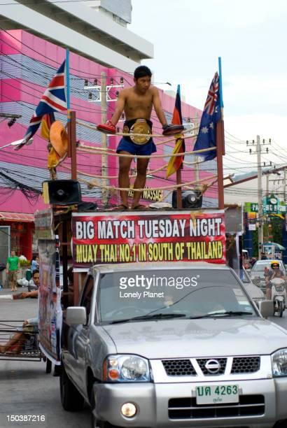 Advertising Thai boxing match.