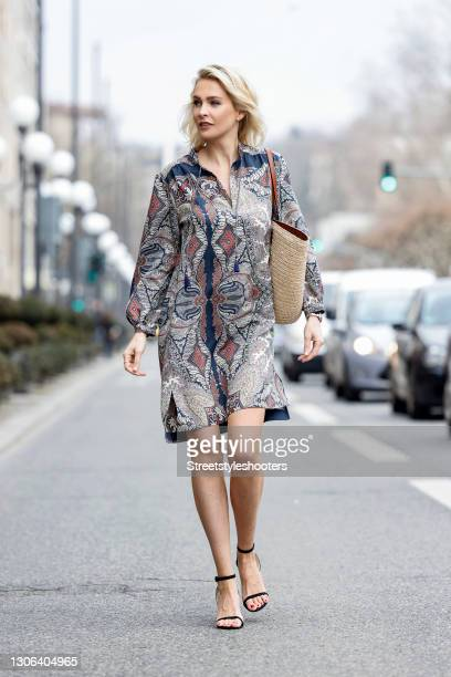 Advertising twin Julia Meise wearing black sandals by H&M, a multicolored midi length dress by Etro and a beige bast bag with brown details by Etro...