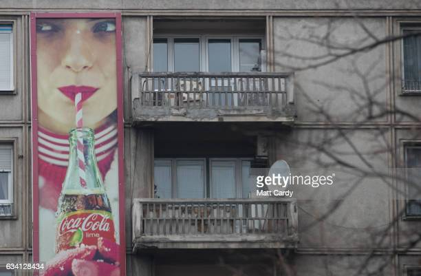A advertisment board for Coca Cola is attached to a apartment block in central Bucharest on February 7 2017 in Bucharest Romania Romania's ruling...