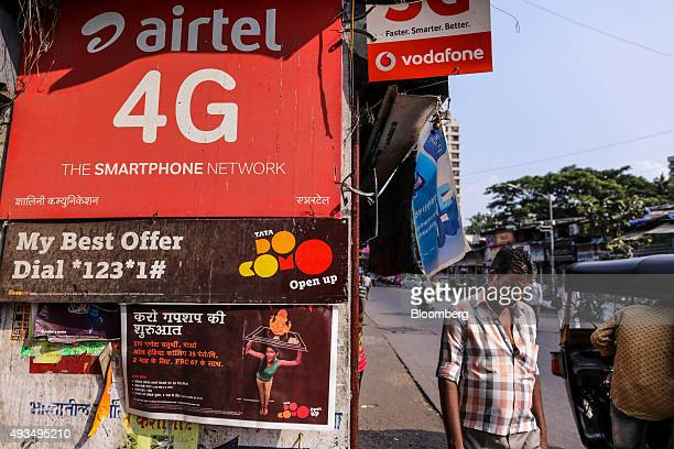 Advertisments for Bharti Airtel Ltd Tata DoCoMo and Vodafone India Ltd are displayed at a store in Mumbai India on Monday Oct 19 2015 Telecom...