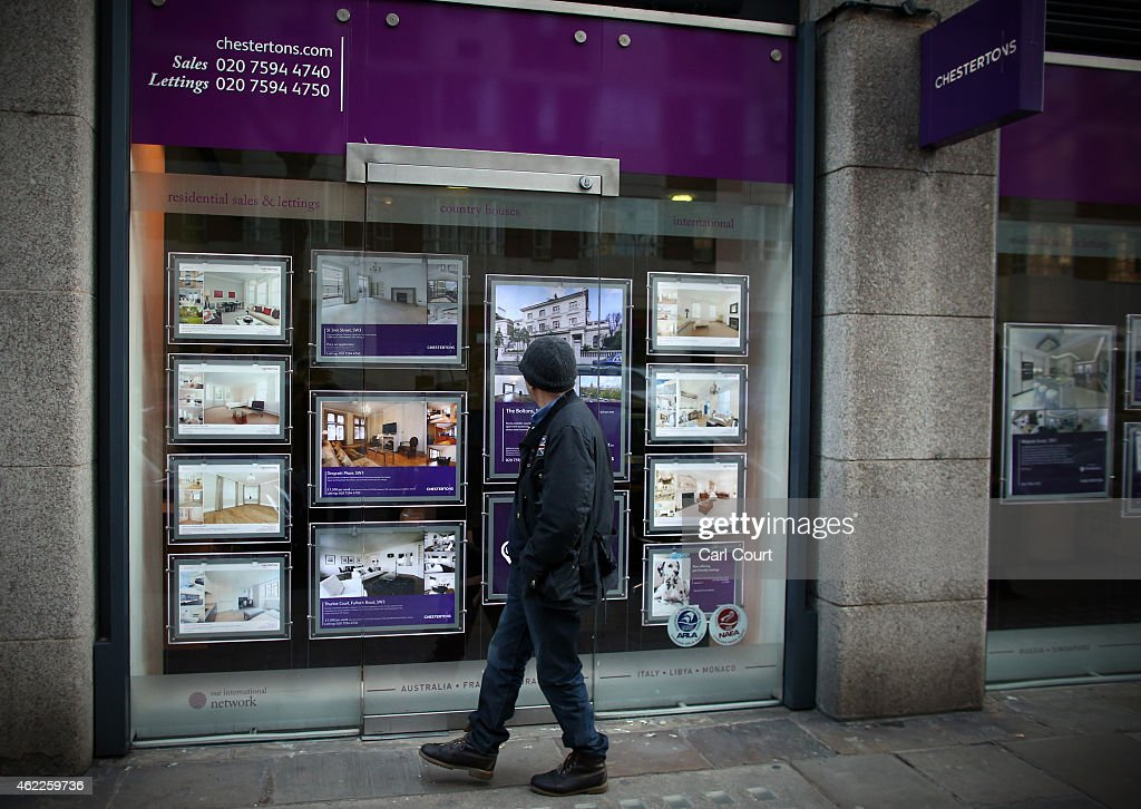 Adverts for luxury properties are seen in the window of an estate agent on January 23, 2015 in west London, England. The Labour Party has proposed a Mansion Tax under which properties over a market value of 2 million GBP would be subject to a levy.