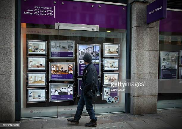 Adverts for luxury properties are seen in the window of an estate agent on January 23 2015 in west London England The Labour Party has proposed a...