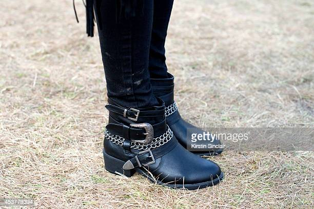Advertsing executive Sophie Gunn wearing Topshop jeans and Office boots at Wilderness Festival on August 09 2014 in Cornbury Park Oxfordshire England