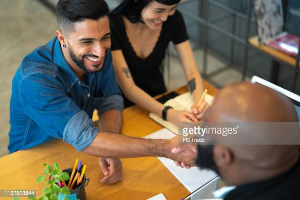 advice and financial review at business meeting - mortgage stock pictures, royalty-free photos & images
