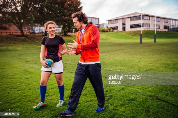 advice from her rugby coach - rugby sport foto e immagini stock