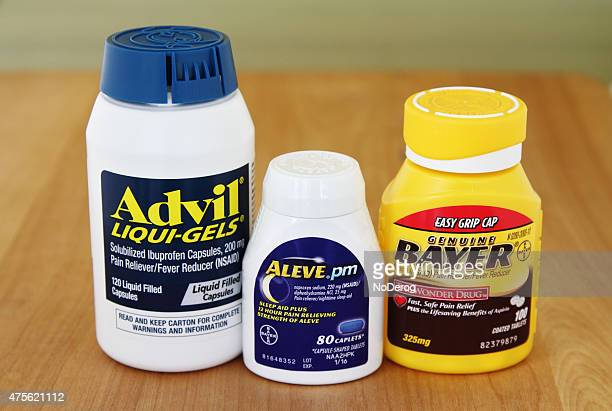 advil, aleve and aspirin pain reliever medicines - ibuprofen stock pictures, royalty-free photos & images