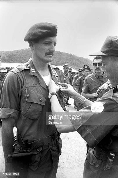 US Advisor Army Captain Wallace Viau Boston MA 1st Special Force Company B gets Vietnamese Cross of Gallantry from Brigadier General Nguyen Huu Co...