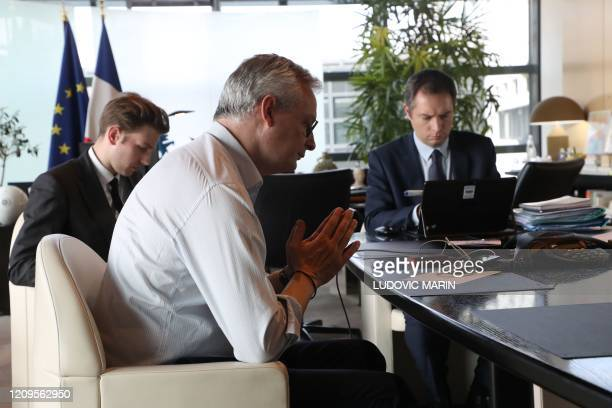 Advisor Charles Sitzewstuhl French economy minister Bruno Le Maire and cabinet deputy director Thomas Revial negociate on the phone prior to an...