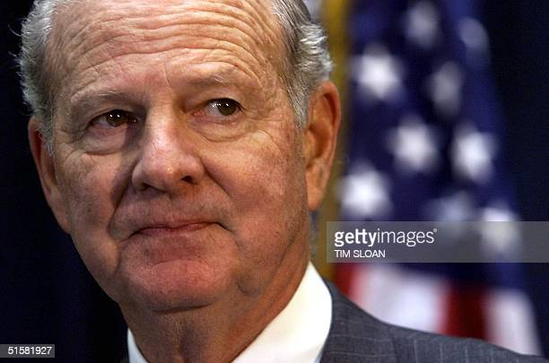 Advisor for Republican presidential candidate George W Bush and former US Secretary of State James Baker responds 04 December in Tallahassee Florida...