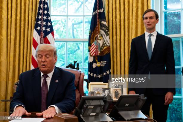 Advisor Jared Kushner looks on as U.S. President Donald Trump speaks in the Oval Office to announce that Bahrain will establish diplomatic relations...