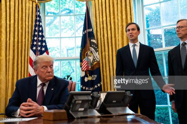 Advisor Jared Kushner speaks as US President Donald Trump listens in the Oval Office to announce that Bahrain will establish diplomatic relations...