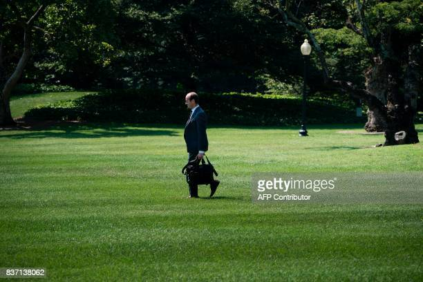 Advisor Stephen Miller follows as US President Donald Trump walks to Marine One on the South Lawn of the White House August 22 2017 in Washington DC...