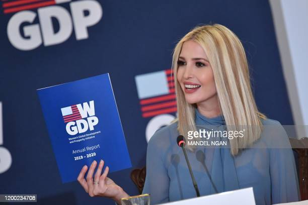 Advisor to the President Ivanka Trump holds up a report as she hosts an event with US Secretary of State Mike Pompeo celebrating the one-year...
