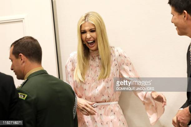 Advisor to the US President Ivanka Trump reacts during an event on the theme Promoting the place of women at work on the sidelines of the G20 Summit...