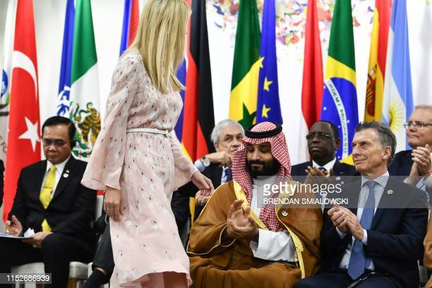 Advisory to the US President Ivanka Trump walks past Saudi Arabia's Crown Prince Mohammed bin Salman and Argentina's President Mauricio Macri after...