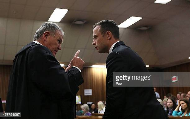 Advocate Barry Roux with Oscar Pistorius at the Pretoria High Court on March 5 in Pretoria, South Africa. Oscar Pistorius, stands accused of the...