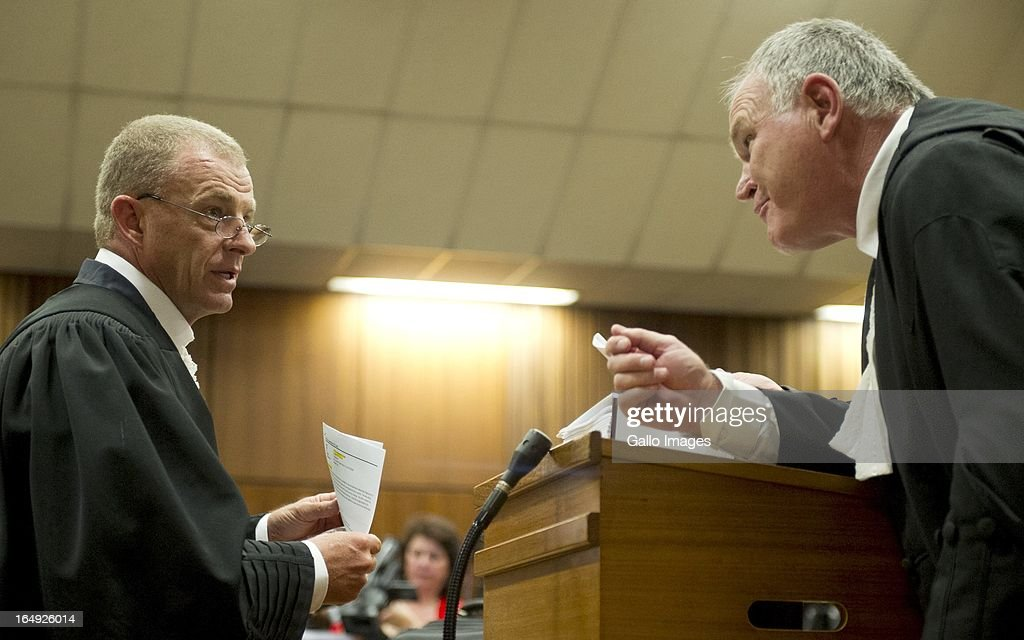 Advocate Gerrie Nel and Advocate Barry Roux during Oscar Pistorius' bail hearing at Pretoria Magistrates Court on March 28, 2013, in Pretoria, South Africa. Oscar Pistorius, who stands accused of shooting Reeva Steenkamp on February 14, 2013, has succesfully appealed his bail conditions, which included travel restrictions.