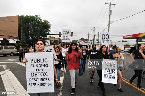 Advocates activists and homeless folks protest through the streets of Kensington to demand adequate shelter and treatment beds for those being...