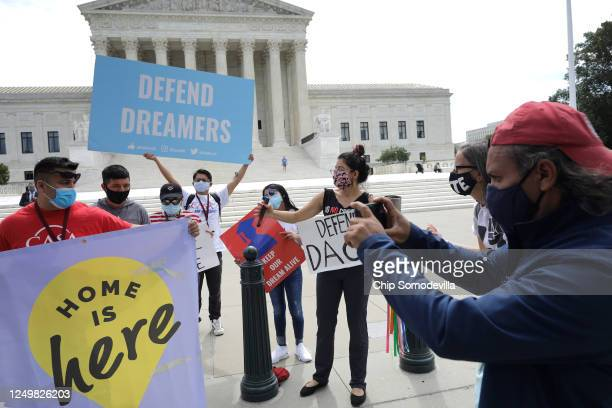 Advocates for immigrants with Deferred Action for Childhood Arrivals or DACA rally in front of the US Supreme Court June 15 2020 in Washington DC The...