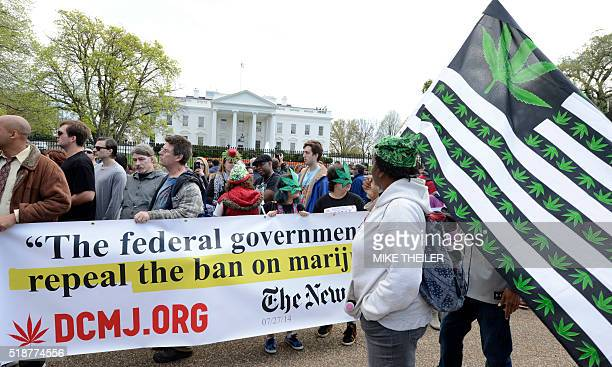 Advocates for the legalization of marijuana gather in front of the White House during a demonstration by dozens who were protesting current laws...