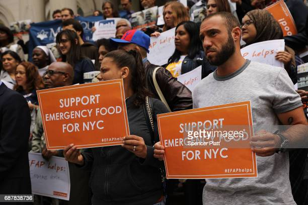 Advocates for the poor and those requiring emergency food assistance join local politicians at City Hall to urge Mayor Bill De Blasio to include $22...