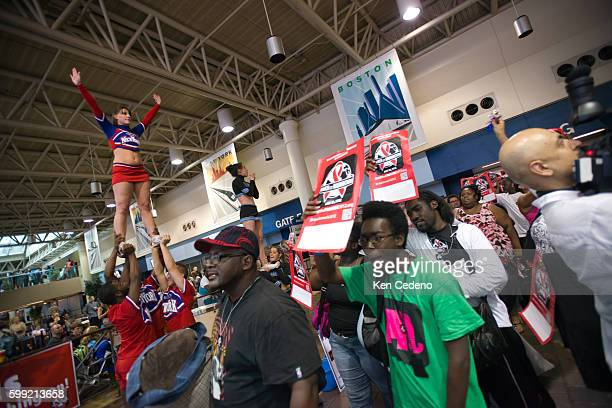 Advocates from eight states are greeted by cheerleaders at Union Station after arriving July 21 2012 to participate in the 'Keep The Promise on...