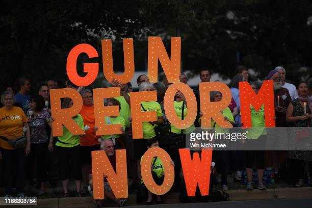 Advocates of gun reform legislation hold a candle light vigil for victims of recent mass shootings outside the headquarters of the National Rifle...