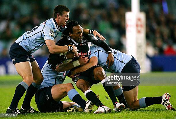 Adwa Ndungane of the Sharks is tackled by the Waratahs defence during the Super 14 semifinal match between the Waratahs and the Sharks at the Sydney...