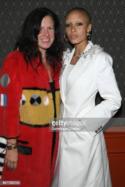 Adwoa Aboah and a guest attend the Miu Miu aftershow party as part of the Paris Fashion Week Womenswear Spring/Summer 2018 at Boum Boum on October 3...