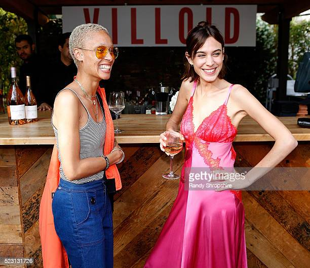 Adwoa Aboah and Alexa Chung attend the Villoid garden tea party hosted by Alexa Chung at the Hollywood Roosevelt Hotel on April 21 2016 in Hollywood...