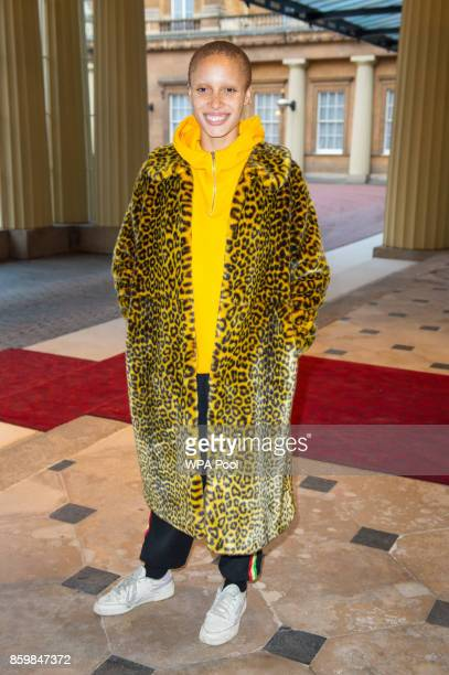 Adwoa Aboah arrives at the Grand Entrance at Buckingham Palace London to attend a reception on World Mental Health Day to celebrate the contribution...